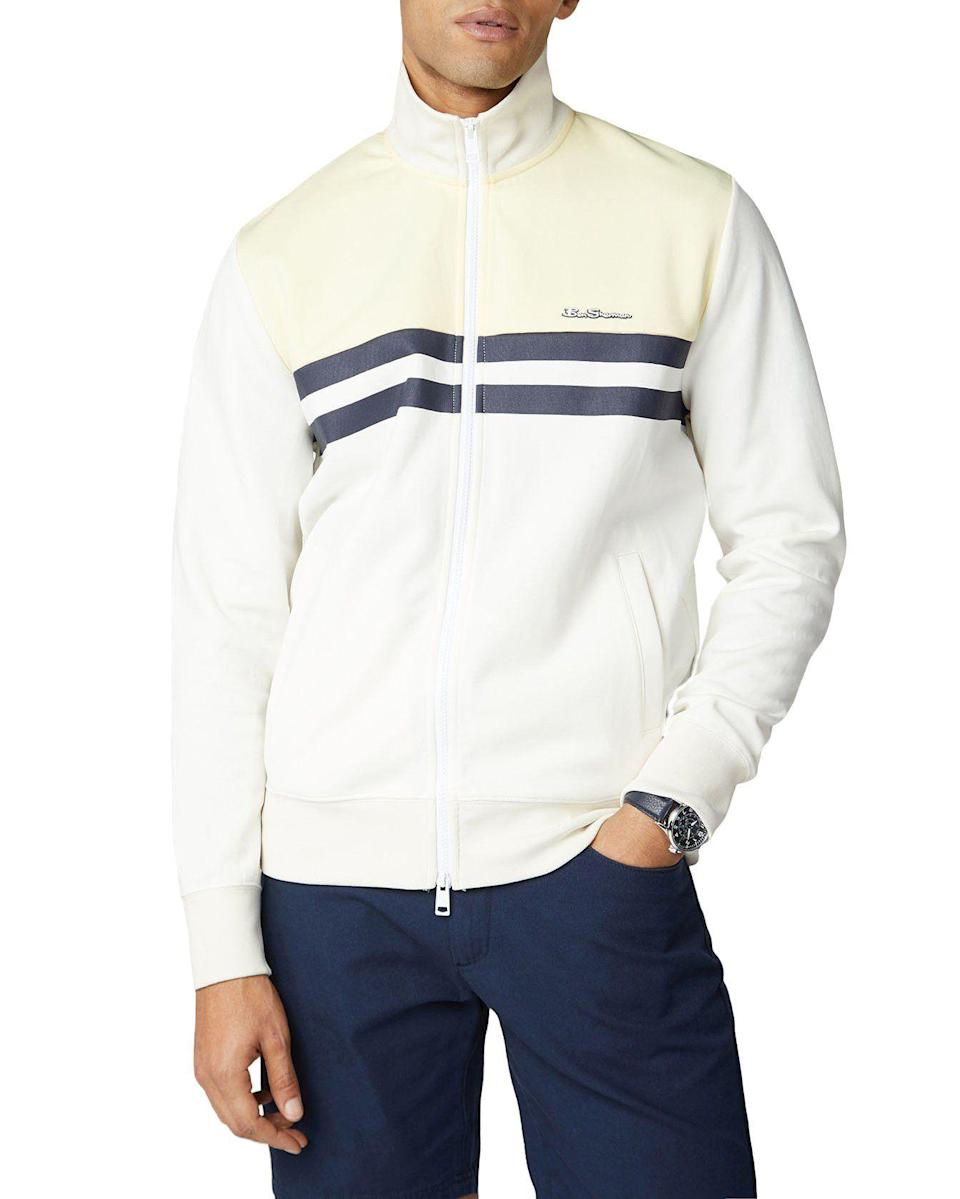 "<p><strong>Ben Sherman</strong></p><p>bensherman.com</p><p><strong>$99.00</strong></p><p><a href=""https://go.redirectingat.com?id=74968X1596630&url=https%3A%2F%2Fwww.bensherman.com%2Fcollections%2Fnew-arrivals%2Fproducts%2F59339-15-color-block-tricot-jacket-ivory&sref=https%3A%2F%2Fwww.redbookmag.com%2Ffashion%2Fg32896039%2Fworking-from-home-summer-style%2F"" rel=""nofollow noopener"" target=""_blank"" data-ylk=""slk:Shop Now"" class=""link rapid-noclick-resp"">Shop Now</a></p><p>A track jacket is the quintessential casual layering piece for warm weather. This variation from Ben Sherman is a slightly elevated, more tailored cousin of the track jacket you'd wear to the gym. It is perfect for WFH, running errands or any time athleisure calls. </p>"