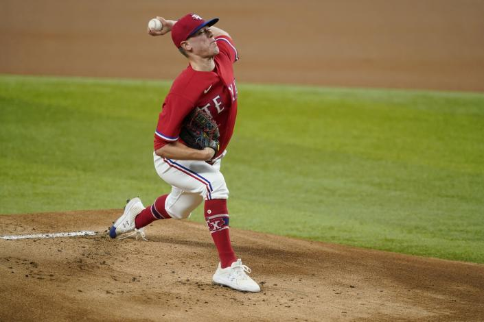 Texas Rangers starting pitcher Kolby Allard throws to a Seattle Mariners batter during the first inning of a baseball game in Arlington, Texas, Friday, July 30, 2021. (AP Photo/Tony Gutierrez)