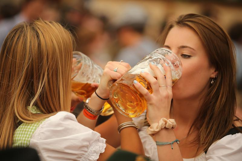 MUNICH, GERMANY - SEPTEMBER 21: Young women enjoy drinking beer out of 1-liter-mugs of beer during the opening weekend of the 2019 Oktoberfest on September 21, 2019 in Munich, Germany. This year's Oktoberfest, which will draw millions of visitors from all over the world, will run from October 21 through October 6. (Photo by Johannes Simon/Getty Images)