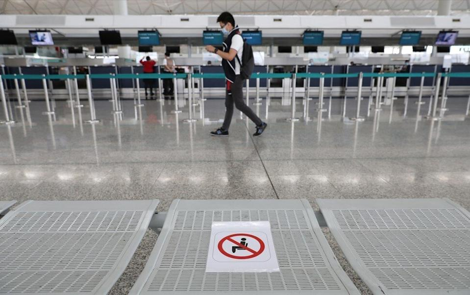 A seat banned for sitting to promote physical distance amid the coronavirus outbreak at the Cathay Pacific check in counters at Hong Kong International Airport on August 12. Photo: Nora Tam