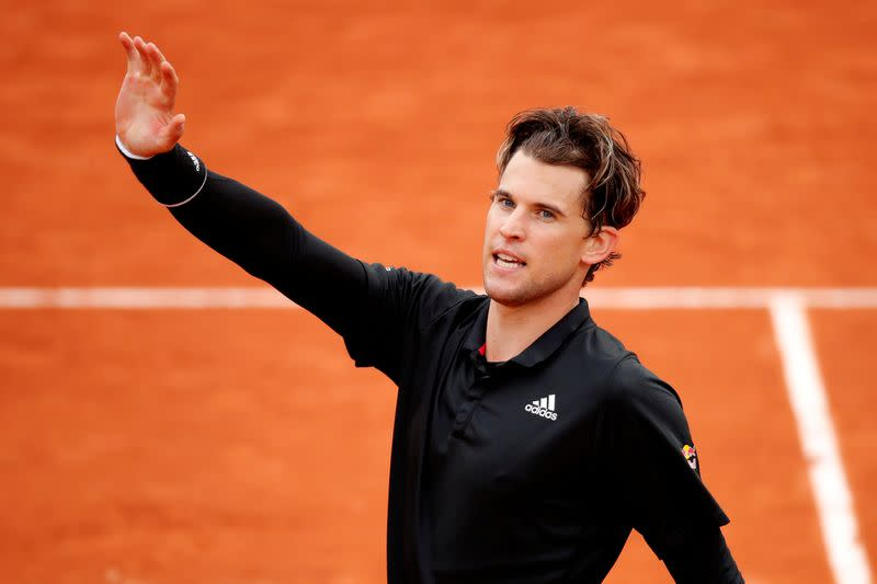 Thiem survives late wobble to ease past American Sock