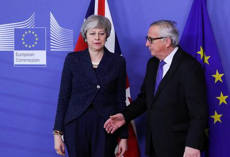 May to hold Brexit talks with EU's Juncker; urges party unity