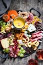 "<p>Make the charcuterie board of your cheese-loving dreams when you prepare this intricate feast. Complete with German beer cheese, blue cheese, mild cow's milk cheese, fresh seasonal fruit, dried fruit, prosciutto, nuts, honey, crackers, and dark chocolate, we'll just say that it doesn't get much better.</p> <p><strong>Get the recipe</strong>: <a href=""https://foxeslovelemons.com/winter-cheese-board-fondue/"" class=""link rapid-noclick-resp"" rel=""nofollow noopener"" target=""_blank"" data-ylk=""slk:winter cheese board with German beer cheese fondue"">winter cheese board with German beer cheese fondue</a></p>"
