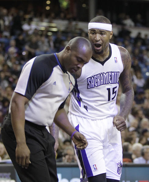 Sacramento Kings center DeMarcus Cousins questions official Courtney Kirkland after he was called for a foul during the first quarter of an NBA basketball game in Sacramento, Calif., Tuesday Feb. 25, 2014. Cousin picked up two technical fouls and was ejected in the third quarter of the Rockets 129-103 win over the Kings(AP Photo/Rich Pedroncelli)