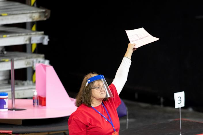 PHOENIX, AZ - MAY 01: A contractor working for Cyber Ninjas, who was hired by the Arizona State Senate, works to recount ballots from the 2020 general election at Veterans Memorial Coliseum on May 1, 2021 in Phoenix, Arizona. / Credit: COURTNEY PEDROZA / Getty Images