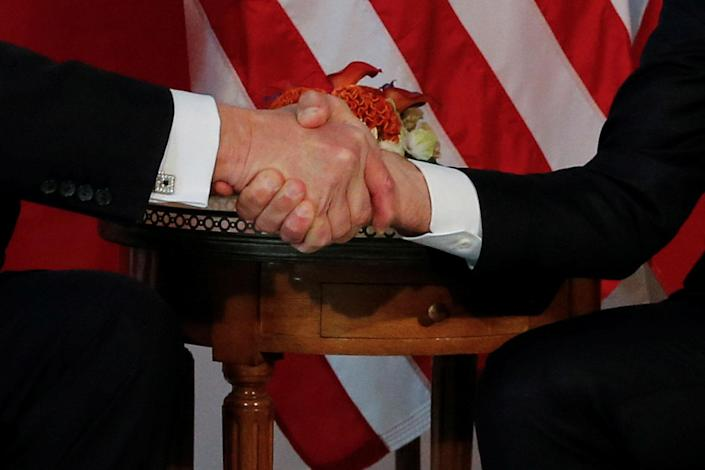 <p>President Donald Trump (L) and France's President Emmanuel Macron shake hands before a working lunch ahead of a NATO Summit in Brussels, Belgium, May 25, 2017. (Photo: Jonathan Ernst/Reuters) </p>