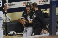 Chicago White Sox's Nick Madrigal is helped into the clubhouse after injuring his arm during the third inning of a baseball game against the Milwaukee Brewers Tuesday, Aug. 4, 2020, in Milwaukee. (AP Photo/Morry Gash)