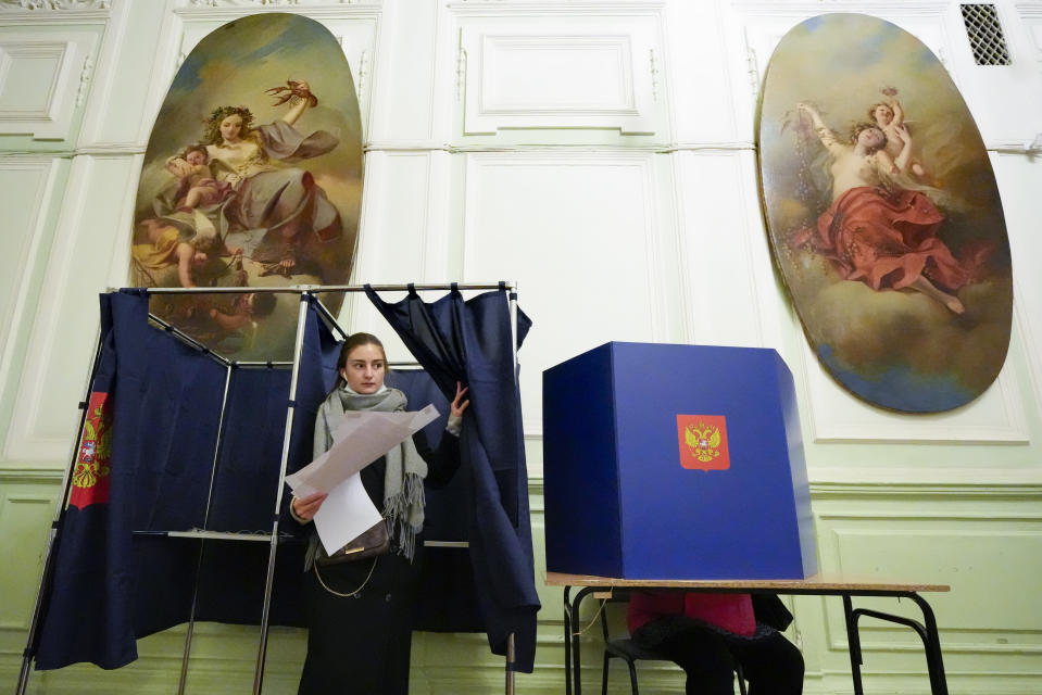 A woman prepares to cast her ballot during the State Duma, the Lower House of the Russian Parliament and local parliaments elections at a polling station situated in an old palace in St. Petersburg, Russia, Saturday, Sept. 18, 2021. Sunday will be the last of three days voting for a new parliament, but there seems to be no expectation that United Russia, the party devoted to President Vladimir Putin, will lose its dominance in the State Duma. (AP Photo/Dmitri Lovetsky)