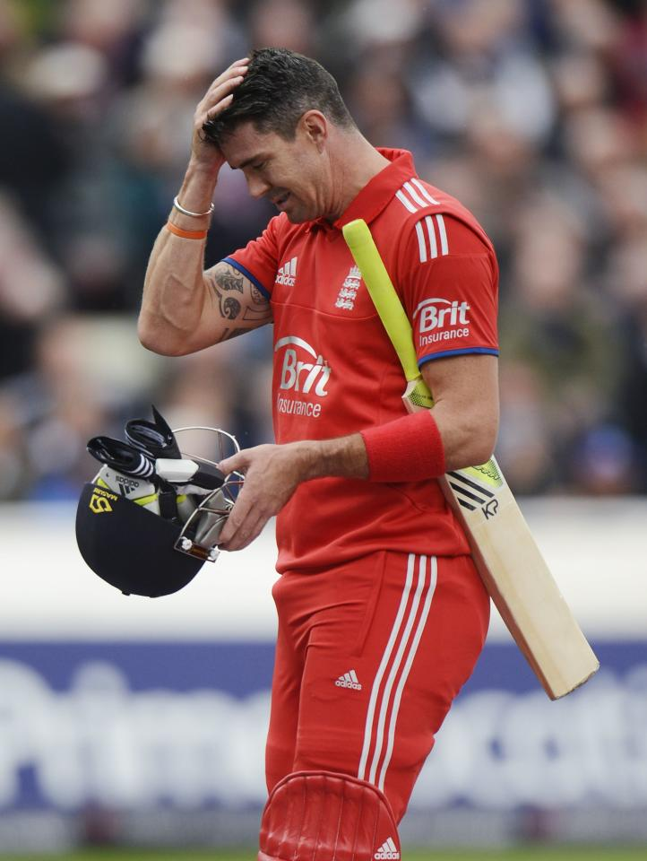 England's Kevin Pietersen leaves the field after being caught during the third one-day international against Australia at Edgbaston cricket ground in Birmingham September 11, 2013. REUTERS/Philip Brown (BRITAIN - Tags: SPORT CRICKET)