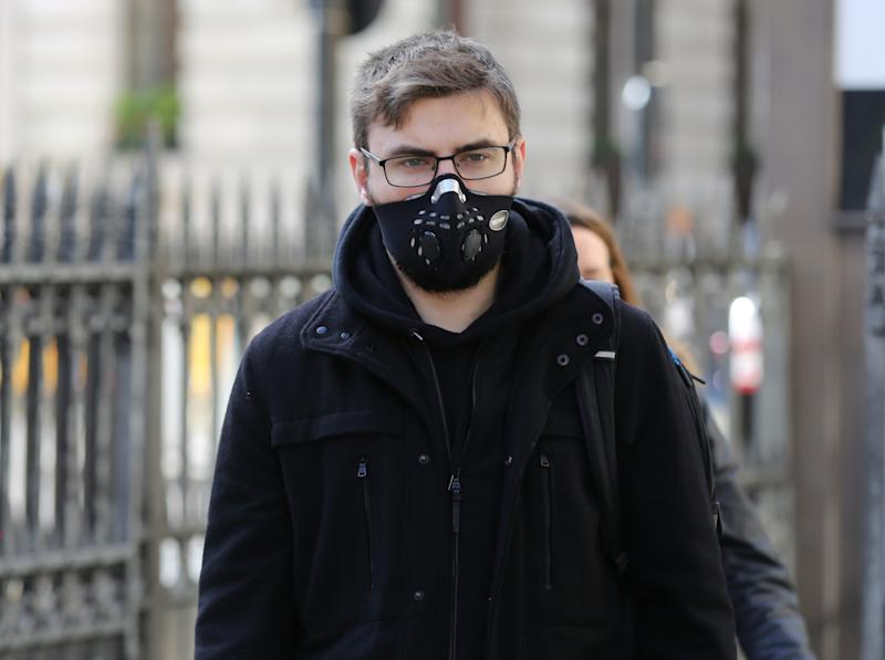LONDON, UNITED KINGDOM - MARCH 17: People wear medical masks as a precaution against coronavirus (COVID-19) in London, United Kingdom on March 17, 2020. UK government updated its coronavirus guidance last night and advised people to work from home where possible and refrain from socialising. (Photo by Ilyas Tayfun Salci/Anadolu Agency via Getty Images)