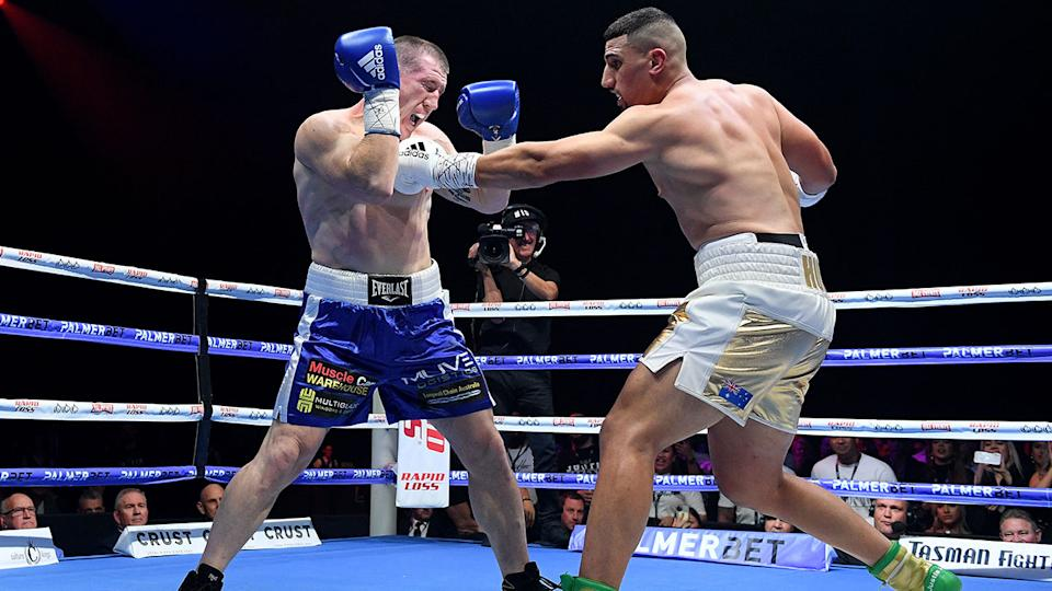 Pictured here, Paul Gallen winces after being hit in the ribs against Justis Huni.