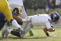 Seattle Seahawks quarterback Russell Wilson, right, gets sacked by Los Angeles Rams defensive end Aaron Donald during the first half in an NFL football game Sunday, Nov. 11, 2018, in Los Angeles. (AP Photo/Alex Gallardo)