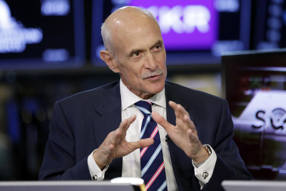 Michael Chertoff, the former U.S. Secretary of Homeland Security, is interviewed on the floor of the New York Stock Exchange, on its first day of trading, Tuesday, July 10, 2018. (AP Photo/Richard Drew)