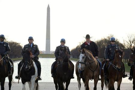 New Interior Secretary Ryan Zinke (2nd from R) rides on horseback with a U.S. Park Police  horse mounted unit while reporting for his first day of work at the Interior Department in Washington, U.S., March 2, 2017.  Tami Heilemann/Department of Interior/Handout via REUTERS