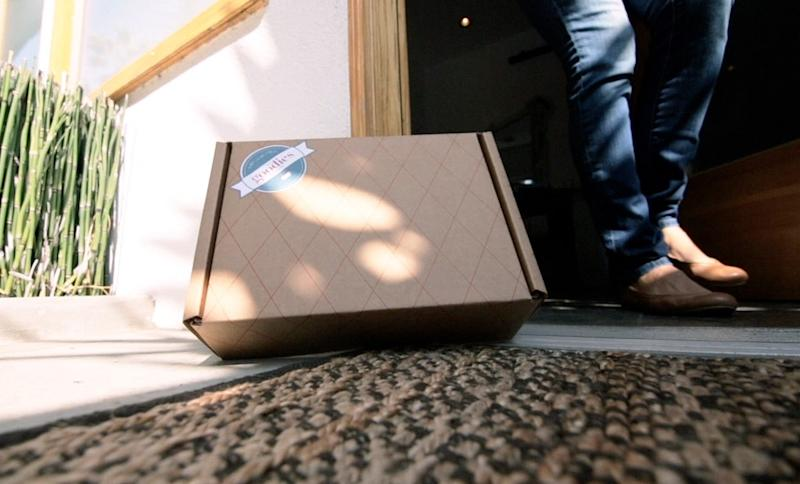 This still frame made from an undated video advertisement provided by Wal-Mart Stores Inc. demonstrates the company's new mail subscription service, called Goodies, that lets shoppers discover new foods from the comfort of their homes. The program will officially launch on Wednesday, Nov. 14, 2012. For  a monthly fee of $7 that includes tax and shipping, customers get a box of five to eight hand-picked, sample-size food items, ranging from organic to ethnic products that are not currently carried on Wal-Mart's shelves. (AP Photo/Wal-Mart)