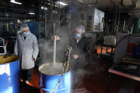 Rabbis Joseph Schwartz, left, and Mendel Einhorn kosherize equipment in boiling water as they help Hanan Products prepare for their kosher-for-passover production run, Thursday, Jan. 7, 2021, in Hicksville, N.Y. At Hanan Products, which since 1946 has made primarily whipped toppings, icings and dessert fillings for the bakery industry, cleaning and production for kosher-for-Passover products begin long before the weeklong holiday that this year starts in late March. (AP Photo/Seth Wenig)