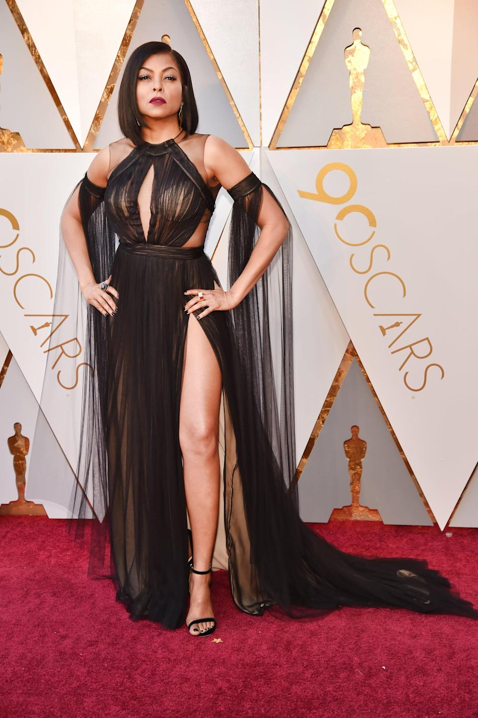 <p>Taraji kept it simple and let the cutouts be the center of attention on this Vera Wang dress. </p>