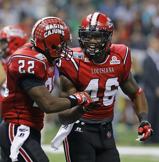 Louisiana-Lafayette running back Alonzo Harris (46) is congratulated by Louisiana-Lafayette running back Elijah McGuire (22) after scoring a touchdown during the first half of the New Orleans Bowl NCAA college football game, Saturday, Dec. 21, 2013, in New Orleans. (AP Photo/Bill Haber)