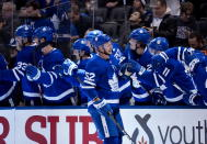 Toronto Maple Leafs defenseman Martin Marincin (52) celebrates his goal with the bench during third-period NHL hockey game action against the Vancouver Canucks in Toronto, Saturday, Feb. 29, 2020. (Frank Gunn/The Canadian Press via AP)