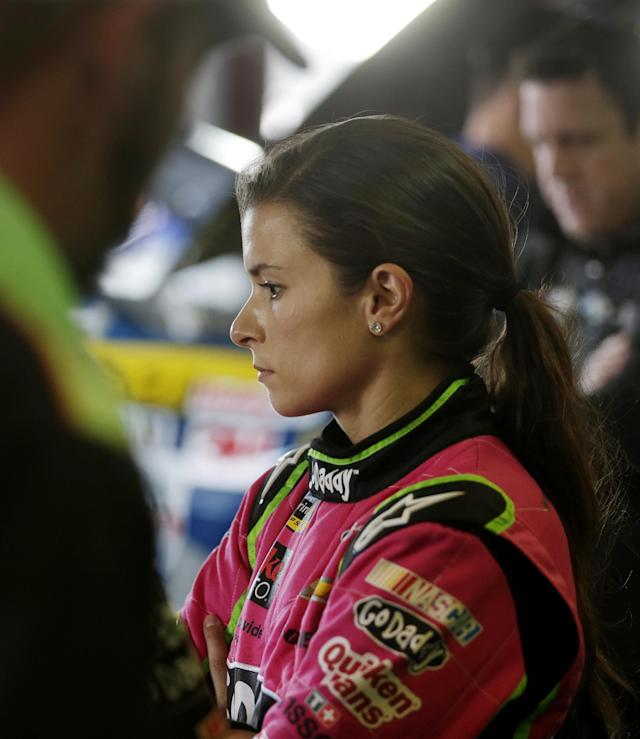 Driver Danica Patrick watches as her pit crew works on her car during practice for Sunday's NASCAR Sprint Cup Series auto race at Talladega Superspeedway in Talladega, Ala., Friday, Oct. 18, 2013.(AP Photo/Jay Sailors)