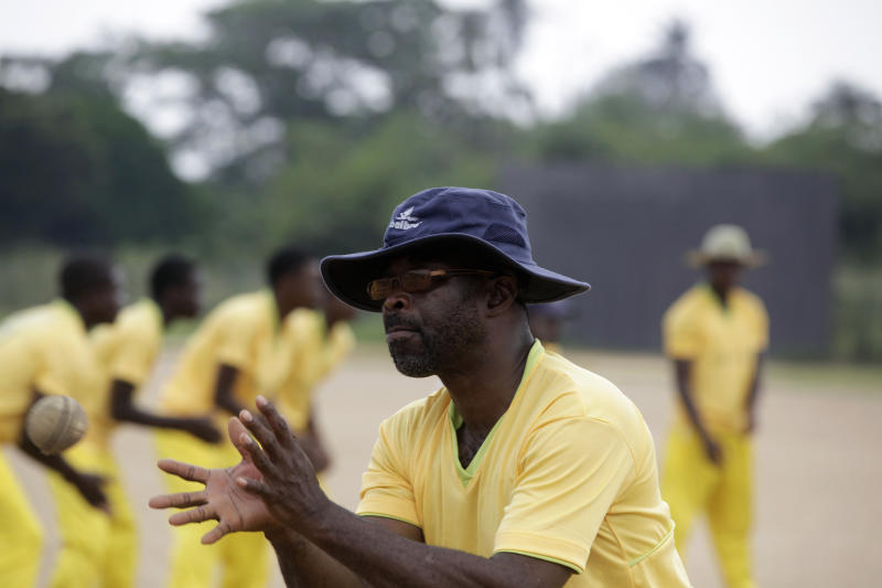 In this photo taken Friday, Nov. 30, 2012, an Ogun state cricket player catches a ball, at a practice session, during the 18th National sports festival in Lagos, Nigeria. Near the parade ground that Queen Elizabeth II once toured when this nation still was under British rule, the sharp crack of a ball against a bat marks the rebirth of a colonial sport now finding a second life. Cricket, once the preserve of Nigeria's educated elite, is finding favor in schools for poor children and in the streets of some of the nation's most violence-torn cities. Yet cricket has a long history in the country. British colonialists introduced the game to boarders in Nigeria's top secondary schools in the 19th century. Nigeria played its first recorded international game in 1904 against present-day Ghana, local cricket officials say. (AP Photo/Sunday Alamba)
