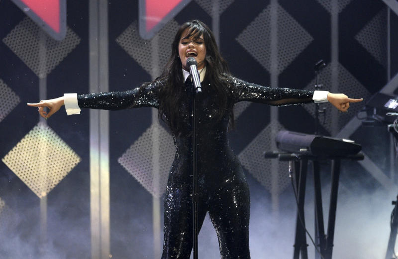 FILE - This Nov. 30, 2018 file photo shows Camila Cabello performing at Jingle Ball in Inglewood, Calif. Cabello is set to perform on the iHeartRadio Jingle Ball Tour this holiday season. IHeartMedia announced Friday, Sept. 27, 2019, that the 12-city tour kicks off Dec. 1 in Tampa Bay, Florida. (Photo by Chris Pizzello/Invision/AP, File)