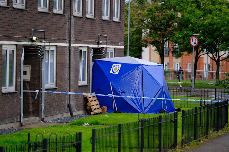 A police tent at scene on Chervil Rise in Wolverhampton. (SWNS)