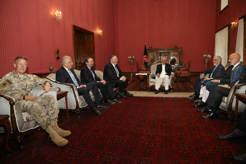 Secretary of State Mike Pompeo meets with, from left, Resolute Support NATO Base Commander Gen. Austin Scott Miller, Afghanistan Envoy Zalmay Khalilzad, U.S. Ambassador to Afghanistan John Bass, Pompeo, Afghan President Ashraf Ghani, Afghan Chief Executive Abdullah Abdullah, and former Afghan President Hamid Karzai, Tuesday, June 25, 2019, during an unannounced visit to Kabul, Afghanistan. (AP Photo/Jacquelyn Martin, Pool)