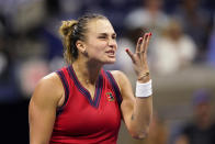 Aryna Sabalenka, of Belarus, reacts after missing a serve to Barbora Krejcikova, of the Czech Republic, during the quarterfinals of the U.S. Open tennis tournament Tuesday, Sept. 7, 2021, in New York. (AP Photo/Frank Franklin II)