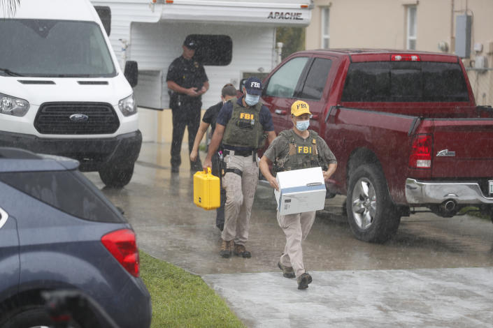 FBI agents remove evidence from the family home of Brian Laundrie in North Port, Fla., on Monday. (Photo by Octavio Jones/Getty Images)