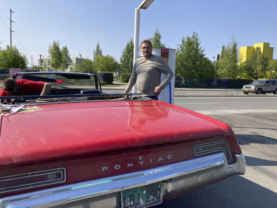 James Grim takes a break from detailing his 1968 Pontiac Catalina convertible at a car wash in Anchorage, Alaska Wednesday, July 1, 2020. Grim said he was upset lawmakers have their hands in the fund and reduced the amount of money that's available for the yearly oil wealth check that is sent to nearly every resident. (AP Photo/Mark Thiessen)