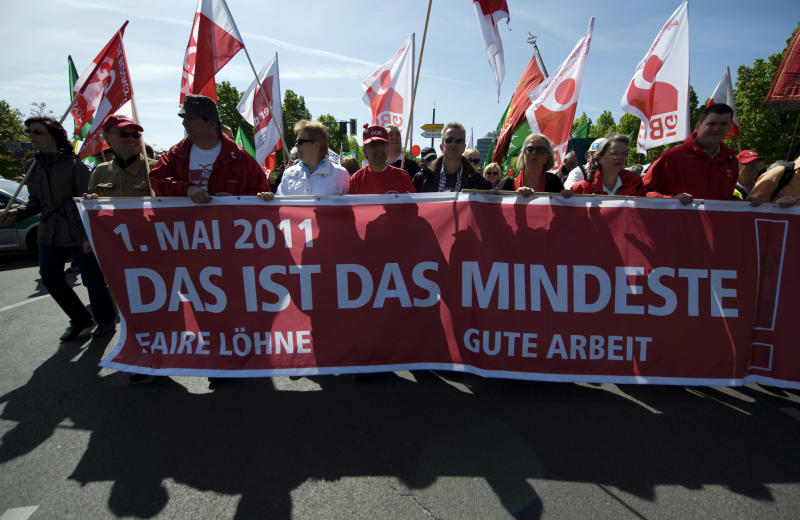 "Participants of a May Day march organized by the German trade union carry flags and banners as they march through Berlin, Germany, Sunday, May 1, 2011. Banner in front reads: "" This is the least, fair salaries, fair jobs"". (AP Photo/dapd, Steffi Loos) GERMANY OUT  AUSTRIA OUT  SWITZERLAND OUT"