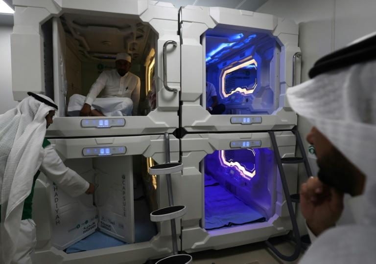 A Saudi man sits inside a sleep pod in Mecca on August 16, 2018