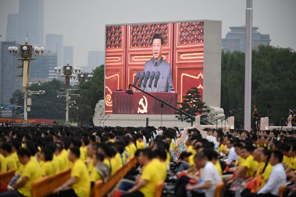 Chinese President Xi Jinping is pictured on screen as he delivers a speech during the 100th anniversary of the Communist Party of China.