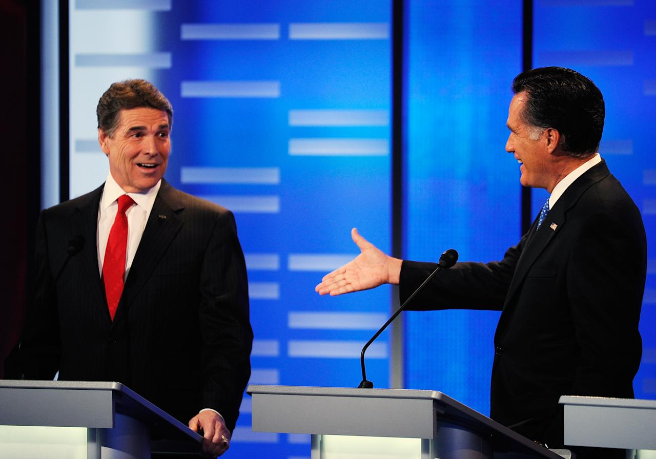 DES MOINES, IA - DECEMBER 10:  Texas Gov. Rick Perry (L) and former Massachusetts Gov. Mitt Romney speak during the ABC News GOP Presidential debate on the campus of Drake University on December 10, 2011 in Des Moines, Iowa. Rivals were expected to target front runner Gingrich in the debate hosted by ABC News, Yahoo News, WOI-TV, The Des Moines Register and the Iowa GOP.  (Photo by Kevork Djansezian/Getty Images)