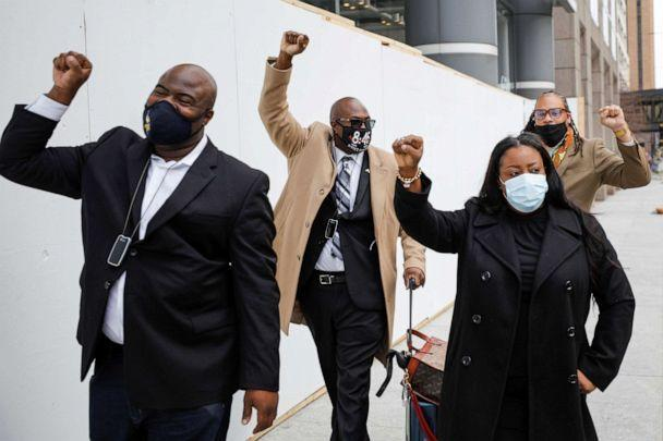 PHOTO: Members of the Floyd family raise their fists on the way to the Hennepin County Government Center on the eighth day in the trial of former police officer Derek Chauvin, in Minneapolis, April 7, 2021. (Nicholas Pfosi/Reuters)