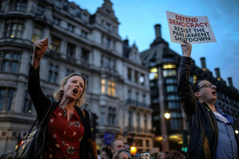 Anti-Brexit supporters take part in a protest in front of the Houses of Parliament in central London, Wednesday, Aug. 28, 2019.