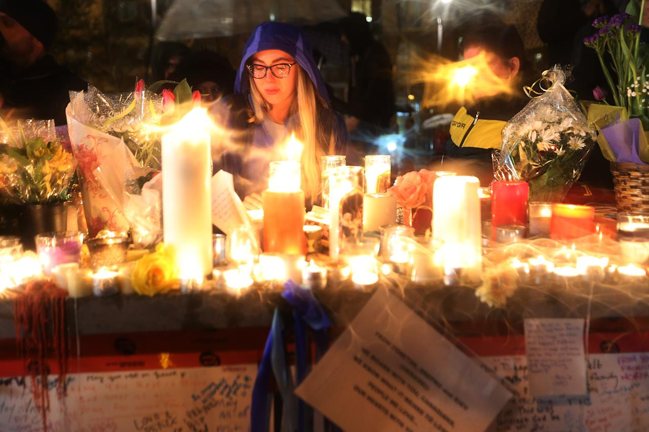 <p>A candle light vigil is held at Olive Square near Yonge and Finch Streets for the victims in the van attack along Yonge Street in Toronto. Steve Russell/Toronto Star via Getty Images </p>