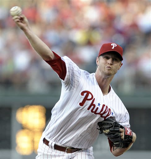 Philadelphia Phillies' Kyle Kendrick throws a pitch in the first inning of a baseball game against the Atlanta Braves on Saturday, July 6, 2013, in Philadelphia. (AP Photo/Michael Perez)