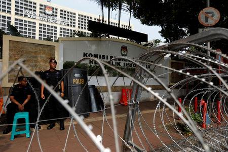Mobile police brigade officers (Brimob) stand guard outside the General Election Commission (KPU) headquarters ahead of the announcement of the presidential election results after the last month election in Jakarta