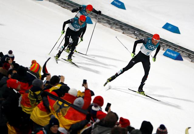 Nordic Combined Events - Pyeongchang 2018 Winter Olympics - Men's Individual 10 km Final - Alpensia Cross-Country Skiing Centre - Pyeongchang, South Korea - February 20, 2018 - Johannes Rydzek of Germany, Fabian Riessle of Germany and Eric Frenzel of Germany approach the finish line. REUTERS/Dominic Ebenbichler TPX IMAGES OF THE DAY