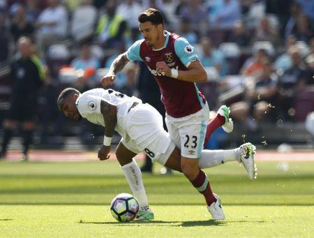 Swansea City's Leroy Fer in action with West Ham United's Jose Fonte