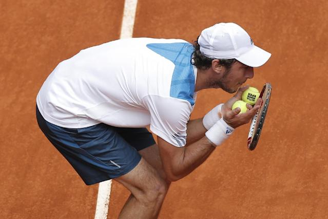 Juan Monaco from Argentina discusses a point with umpire Carlos Bernardes during a Madrid Open tennis tournament match against Rafael Nadal from Spain in Madrid, Spain, Wednesday, May 7, 2014. (AP Photo/Andres Kudacki)