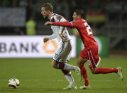 Germany's Lukas Podolski (L) fends off a tackle attempt by Gibraltar's defender Jean Carlos Garcia during their UEFA 2016 European Championship qualifying round Group D match in Nuremberg, on November 14, 2014 (AFP Photo/Christof Stache)