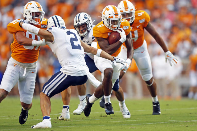 Tennessee running back Ty Chandler (8) runs for yardage trying to avoid defense by Brigham Young defensive back Austin Lee (2) in the first half of an NCAA college football game Saturday, Sept. 7, 2019, in Knoxville, Tenn. (AP Photo/Wade Payne)