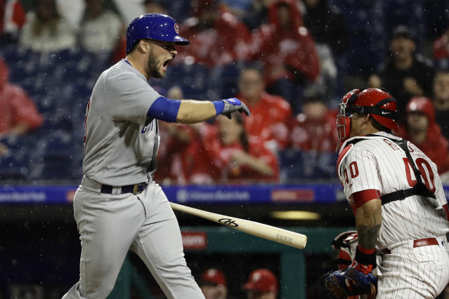 Chicago Cubs' David Bote, left, reacts after striking out to Philadelphia Phillies starting pitcher Nick Pivetta during the fourth inning of a baseball game Friday, Aug. 31, 2018, in Philadelphia. At right is catcher Wilson Ramos. (AP Photo/Matt Slocum)