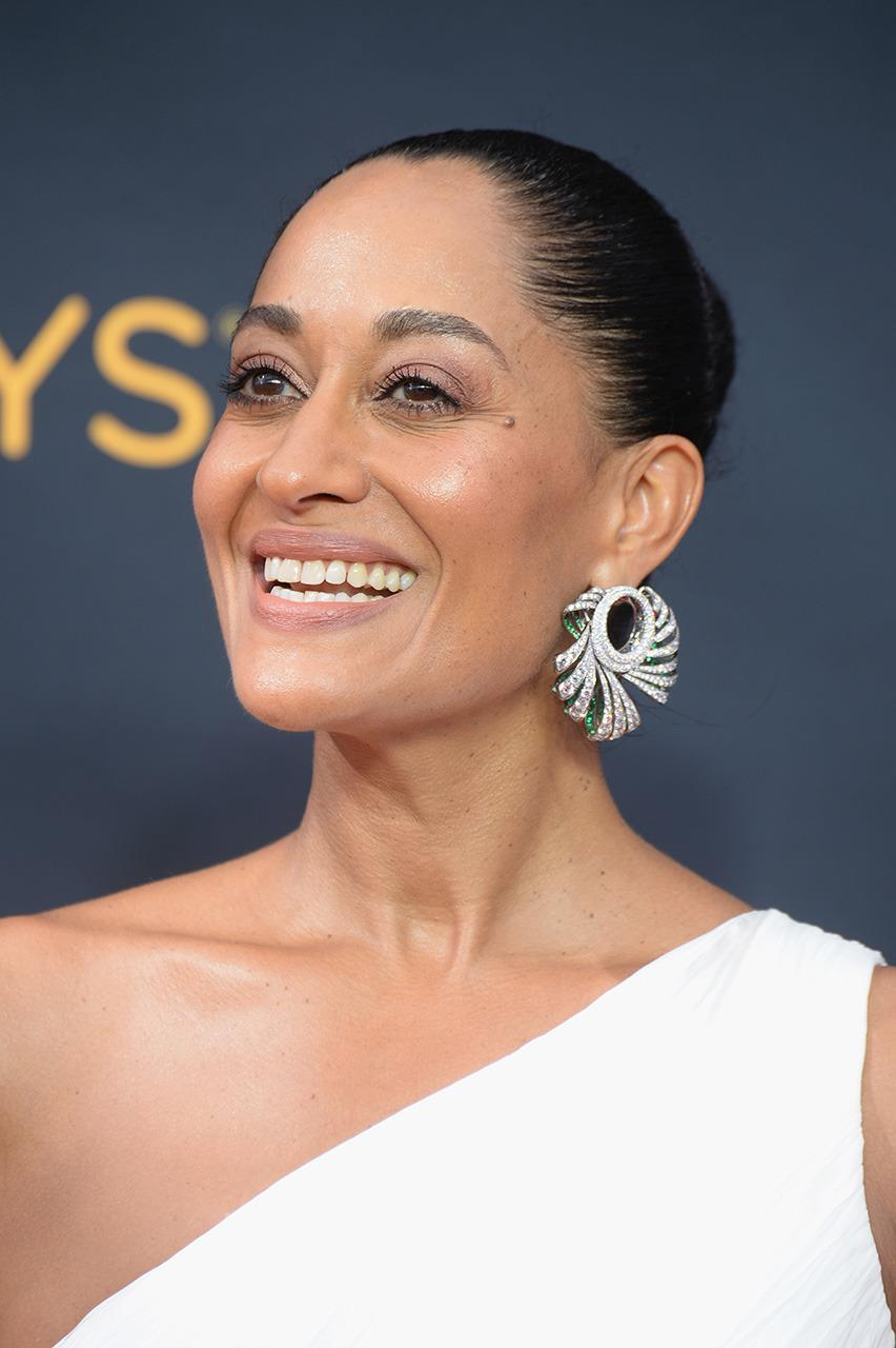 <p><b>Tracee Ellis Ross</b></p><p>The <i>Black-ish</i> star let her earrings and smile shine brighter with her hair pulled back. (Photo: Getty Images)<br></p>