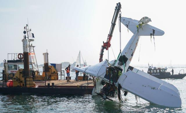 The bi-plane is lifted from Poole harbour following the crash (Andrew Matthews/PA)