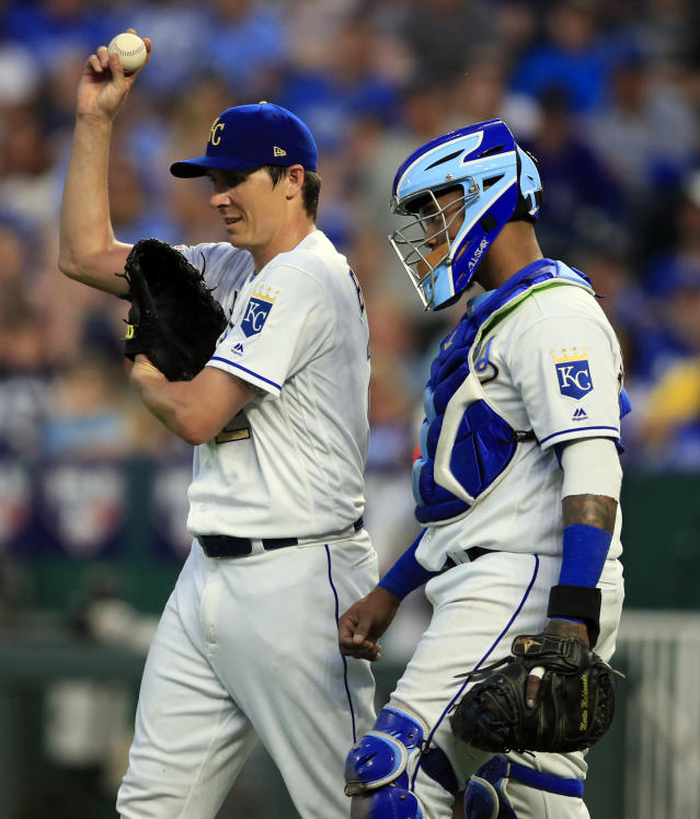 Kansas City Royals starting pitcher Homer Bailey, left, talks with catcher Martin Maldonado, right, during the fifth inning of the team's baseball game against the Chicago White Sox at Kauffman Stadium in Kansas City, Mo., Friday, June 7, 2019. (AP Photo/Orlin Wagner)