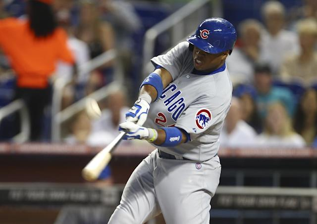 Chicago Cubs' Luis Valbuena bats during the first inning of a baseball game against the Miami Marlins, in Miami, Tuesday, June 17, 2014. (AP Photo/J Pat Carter)